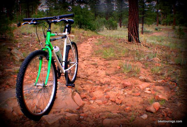 Picture of rugged mountain bike trails with vintage steel rigid mountain bike