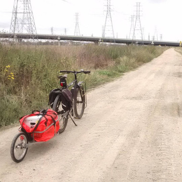 Picture of bike trailer and touring bike on gravel road