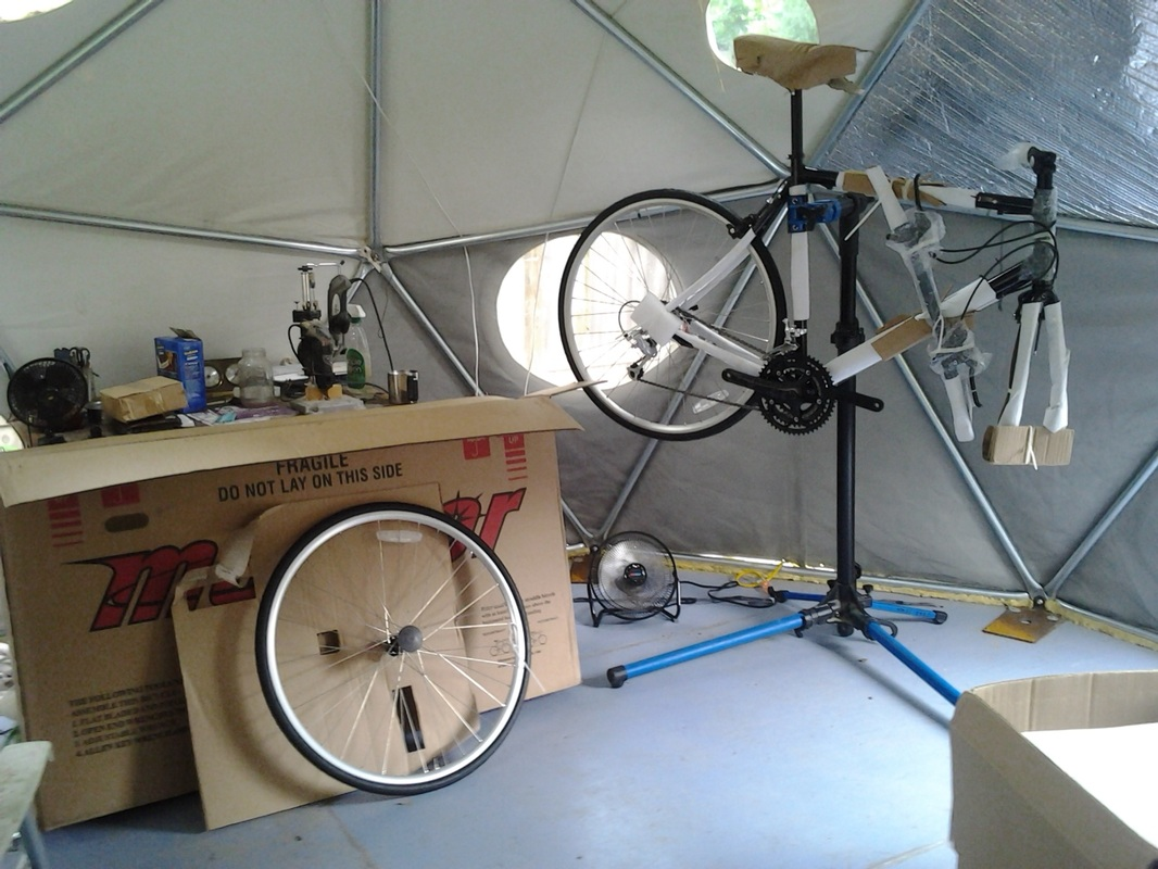 Picture of bike tourings work shop intereor with new bicycle build