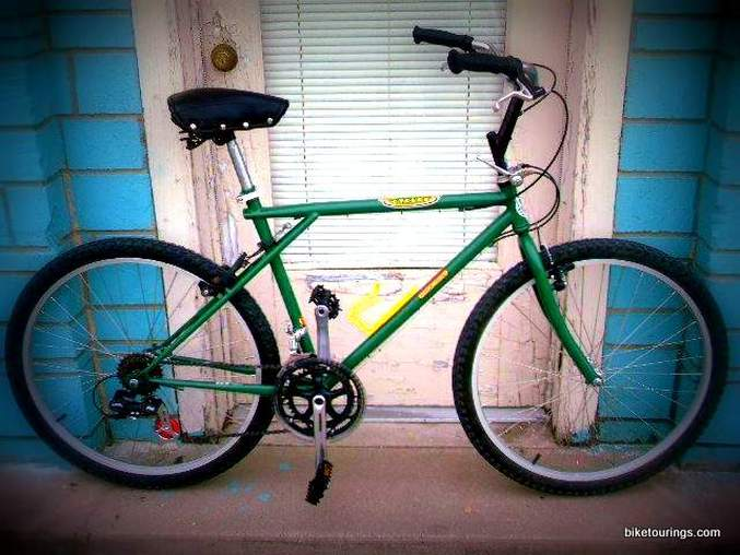 Picture of an old GT mountain bike frame converted to comfy commuter bike