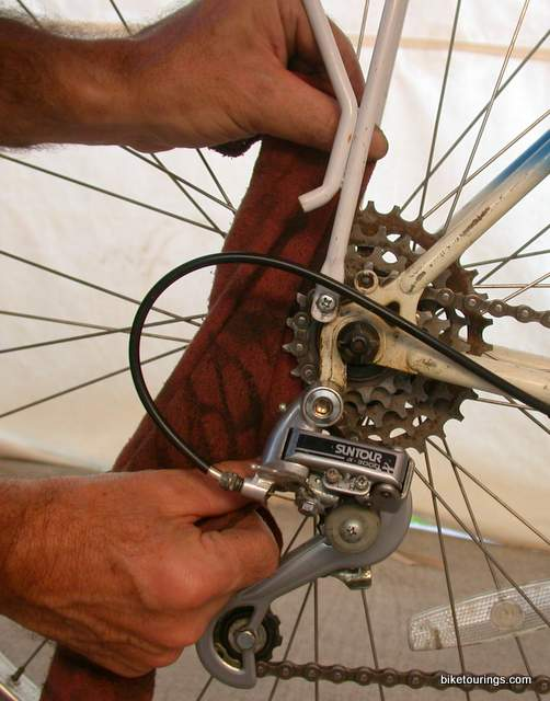 Picture of bike commuter cleaning bike chain