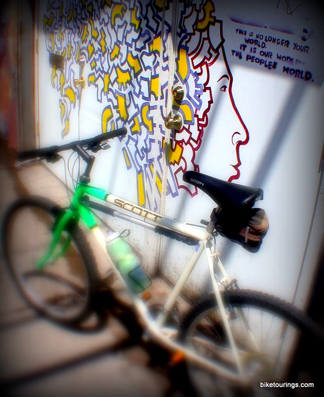 Picture of bike touring alleys with cool art work