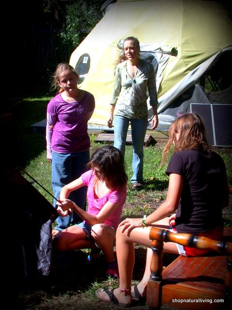 Picture of Lisa Piper of Natural Living teaching at kid's cooking campout