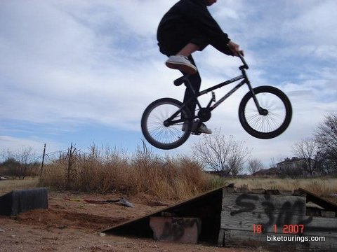 Picture of BMX bike commuter jumping off of ramp