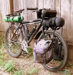 Picture of touring bike with racks, panniers, handlebar bag for bike touring