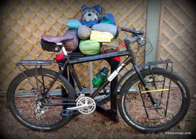 Picture of mountain bike and packing gear for bike camping