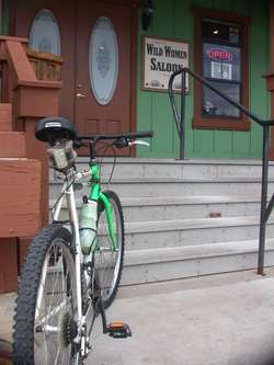 Picture of mountain bike parked in front of saloon