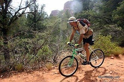 Picture of mountain bike touring with shade hat
