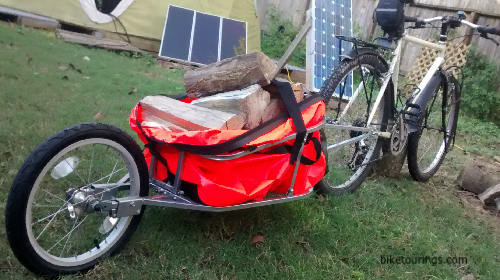 Picture of bike trailer filled with fire wood.