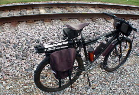 Picture of touring bike on gravel road with panniers