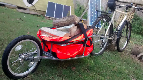 Picture of Aosom single wheel bike trailer and waterproof dry bag.