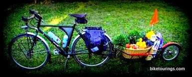 Picture of touring bike and bicycle trailer used for Food Delivery