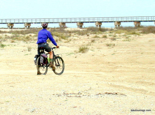 Picture of mountain bike touring on beach