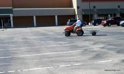 Picture of old man commuting on a lawn mower