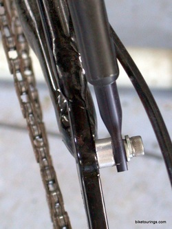 Picture of mountain bike rear rack install disc brake.
