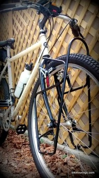 Picture of mountain bike for touring with lowrider style front bike rack for bicycle touring