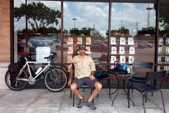 Picture of bike commuter sitting outside coffee shop