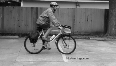 Picture of bike commuter with rain jacket cycling apparel