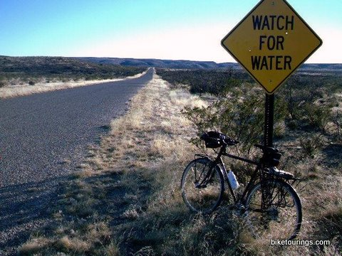 Picture of Surly Crosscheck touring bike on desert highway