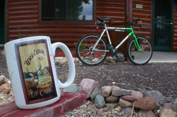 Picture of mountain bike parked in front of cabin