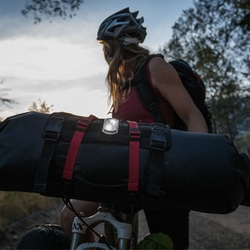 Picture of woman bike packing with blackburn 2 fer front or rear light