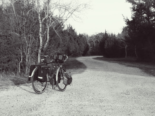 Picture of touring  bike on gravel road with Schwalbe Mondial Tires