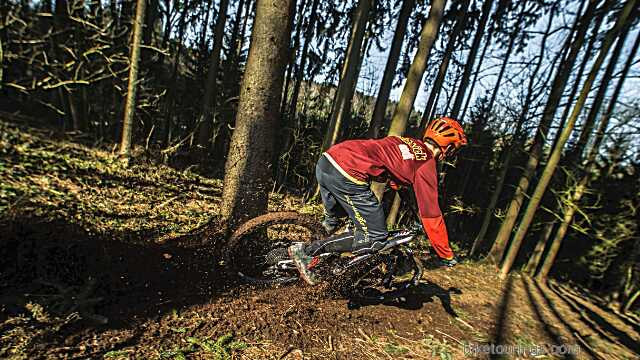 Picture of mountain bike rider testing mountain bike on trails