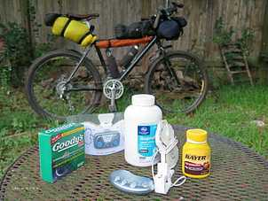 Picture of assorted pain relief remedies for sciatic pain with touring bike