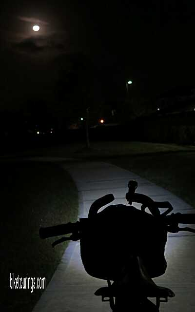 Picture of bike touring at night with front bicycle light
