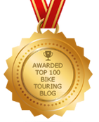 Picture of feedspot top one hundred bike touring blog badge